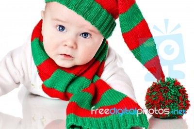 baby with christmas hat and scarf stock photo