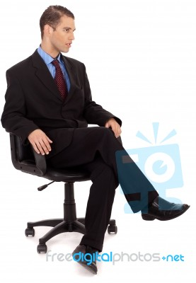 Business Man Sitting In Chair Stock Photo