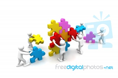 business teamwork building puzzles together stock image