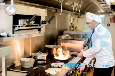 Chef Preparing Cuisine In Hotel Kitchen Stock Photo - Royalty Free ...