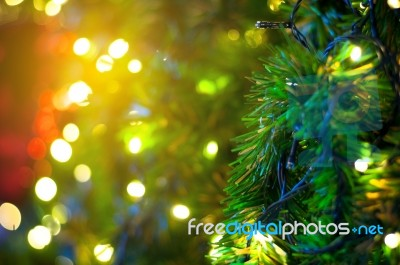 close up christmas tree with wire white light background stock photo