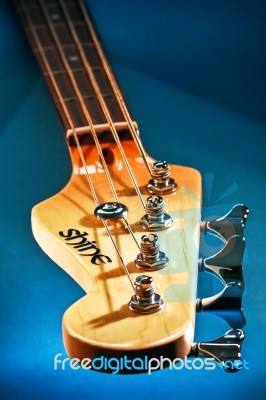 close up electric bass guitar head and tuning pegs stock photo royalty free image id 100525822. Black Bedroom Furniture Sets. Home Design Ideas