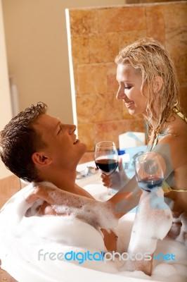 Couple Having Bath With Wine Stock Photo
