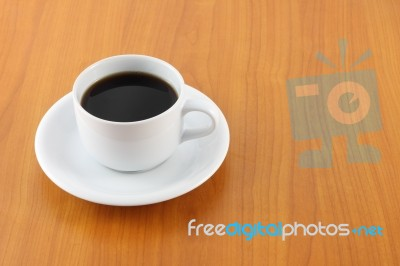 cup of coffee on wooden table stock photo - royalty free image id