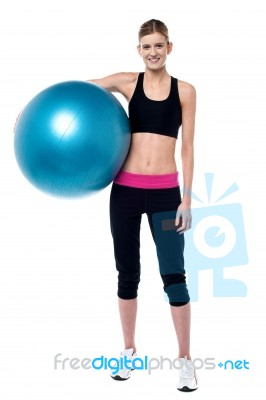 female fitness trainer holding aerobic ball stock photo