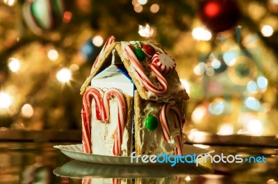 Christmas Gingerbread House Background.Gingerbread House Against A Background Of Christmas Tree