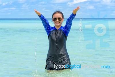 Happy Asian Teen Girl Play Splashing Water In The Sea Stock Photo Royalty Free Image Id 100653901 Download 41,363 asian teen images and stock photos. freedigitalphotos net