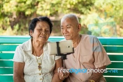Happy Senior Couple Posing For A Selfie Stock Photo