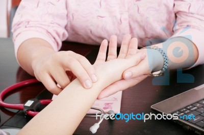 Nurse Checking Pulse Of Patient Stock Image - Image of