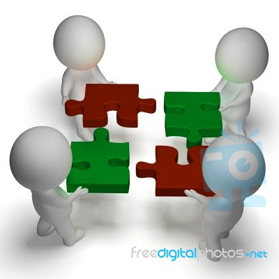 jigsaw pieces being joined shows teamwork and assembling stock image