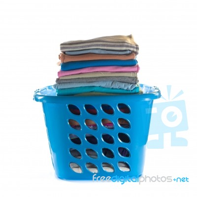 laundry basket with folded clothes stock photo royalty