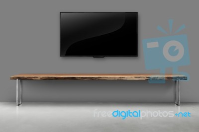 Led Tv On Concrete Wall With Wooden Furniture In Living Room Stock Photo Royalty Free Image Id