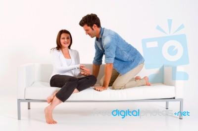 Loving Sitting In Sofa Stock Photo