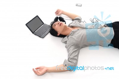 Man Lying On Floor Stock Photo