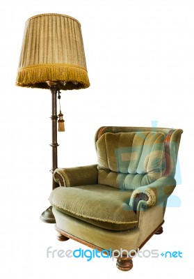 Old Armchair With Lamp Stock Photo