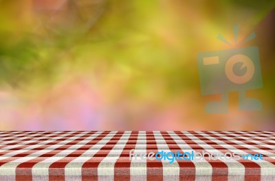 picnic table with blurred autumn leaves background stock photo
