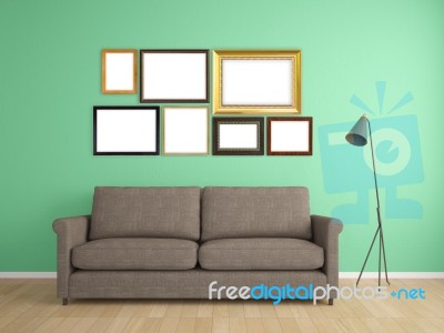 picture frame on wall and sofa interior furniture design stock