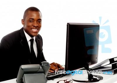 smiling businessman using computer stock photo royalty free image
