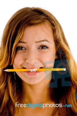 smiling girl biting pencil stock photo royalty free image id 10092514