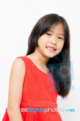 Smiling Little Asian Girl In Red Dress Stock Photo