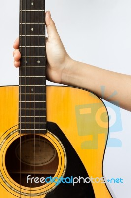 Woman S Hand Holding Acoustic Guitar On White Background Stock Photo
