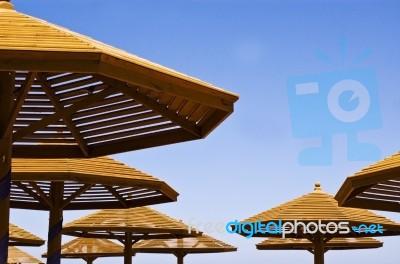Wooden Beach Umbrellas Stock Photo