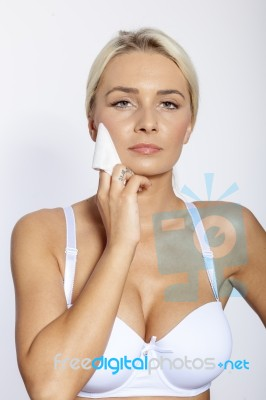 Young Woman Clean Face With Wet Wipes Stock Photo - Royalty Free ... 6a00e3b19